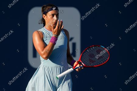 Caroline Garcia, of France, prepares to play during a tennis match against Simona Halep, of Romania, during the Miami Open tennis tournament, in Miami Gardens, Fla