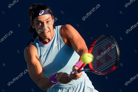 Caroline Garcia, of France, returns a shot from Simona Halep, of Romania, at the Miami Open tennis tournament, in Miami Gardens, Fla