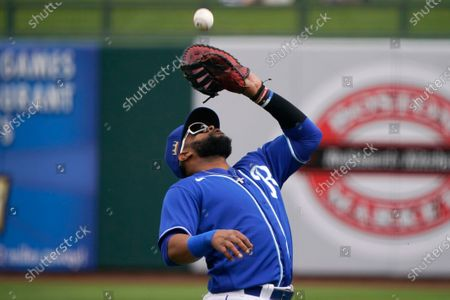 Kansas City Royals' Carlos Santana catches a popup hit by Arizona Diamondbacks' Trayce Thompson for an out in the second inning of a spring training baseball game, in Surprise, Ariz