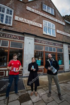 Stock Image of The Carlton Tavern pub in South Kilburn was unlawfully demolished, and has has now been built back brick by brick, after pressure from local residents including Polly Amos Robertson (centre). Pictured with Landlords Ben Martin (left) and Tom Rees.The pub garden will reopen 12th April 2021