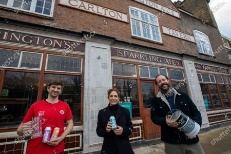 The Carlton Tavern pub in South Kilburn was unlawfully demolished, and has has now been built back brick by brick, after pressure from local residents including Polly Amos Robertson (centre). Pictured with Landlords Ben Martin (left) and Tom Rees.The pub garden will reopen 12th April 2021