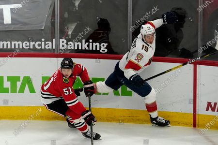 Stock Image of Florida Panthers left wing Mason Marchment (19) is checked by Chicago Blackhawks defenseman Ian Mitchell (51) during the third period of an NHL hockey game in Chicago