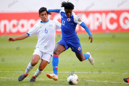 Melvin Cartagena (L) of El Salvador in action against Roberto Louima of Haiti during the CONCACAF Men's Olympic Qualification tournament soccer match at Jalisco Stadium in Guadalajara, Mexico, 25 March 2021.