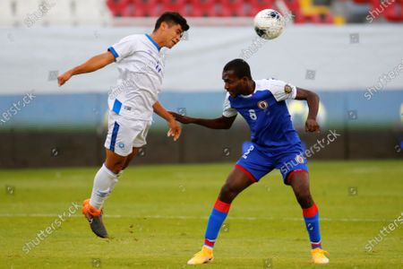 Melvin Cartagena (L) of El Salvador in action against Clifford Thomas of Haiti during the CONCACAF Men's Olympic Qualification tournament soccer match at Jalisco Stadium in Guadalajara, Mexico, 25 March 2021.