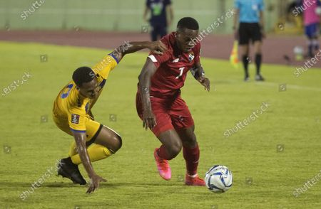 Jose Luis Rodriguez (R) of Panama in action against Handan Holligan of Barbados during a Qatar 2022 World Cup Qualifying round soccer match at Felix Sanchez stadium in Santo Domingo, Dominican Republic, 25 March 2021.