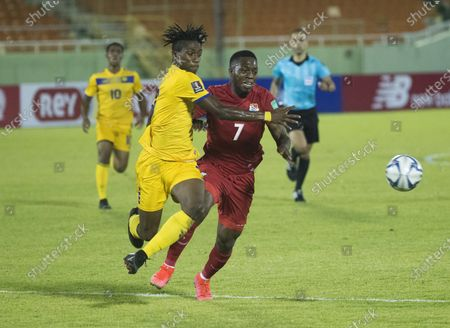 Jose Luis Rodriguez (R) of Panama in action against Carl Hinkson of Barbados during a Qatar 2022 World Cup Qualifying round soccer match at Felix Sanchez stadium in Santo Domingo, Dominican Republic, 25 March 2021.