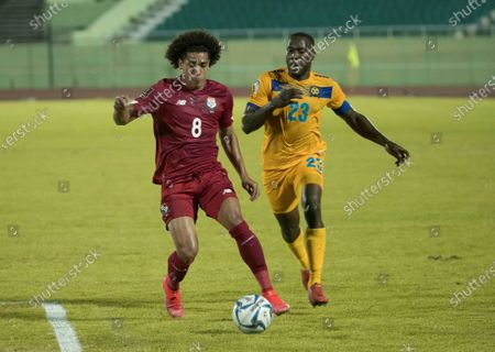 Adalberto Carrasquilla (L) of Panama in action against Rashad Jules of Barbados during a Qatar 2022 World Cup Qualifying round soccer match at Felix Sanchez stadium in Santo Domingo, Dominican Republic, 25 March 2021.