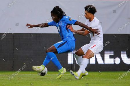 Jose Garcia (L) of Honduras in action against Tajon Buchanan of Canada during the CONCACAF Men's Olympic Qualifying tournament soccer match at Jalisco Stadium in Guadalajara, Mexico, 25 March 2021.