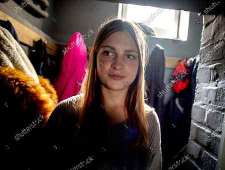 13-year-old daughter Anni walks through the family's house in Eisemroth, central Germany, . One year into the coronavirus pandemic, Katja Heimann is still trying to keep her spirits up _ despite several lockdowns and months of teaching seven of her children in home schooling