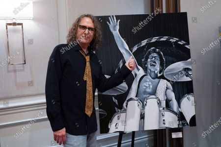 John Douglas standing next to a painting he did, Delray Beach, FL.