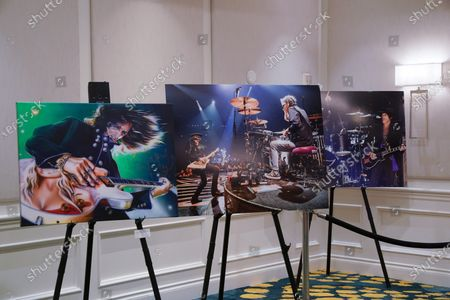 John Douglas artwork and a photo of him playing drums for Aerosmith, Delray Beach, FL.