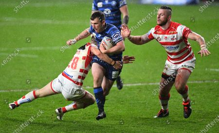 Stock Picture of Harry Smith of Wigan Warriors is tackled by Matthew Foster of Leigh Centurions