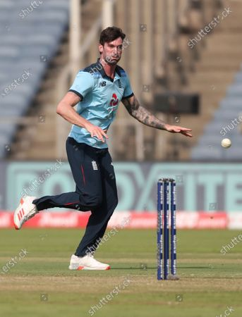 England's Reece Topley runs to field the ball during the second One Day International cricket match between India and England at Maharashtra Cricket Association Stadium in Pune, India
