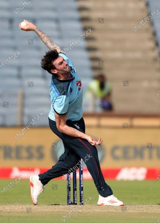 England's Reece Topley bowls a delivery during the second One Day International cricket match between India and England at Maharashtra Cricket Association Stadium in Pune, India