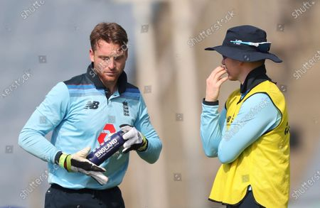 Stock Picture of England's injured captain Eoin Morgan, right, interacts with stand-in-captain Jos Buttler at drinks break during the second One Day International cricket match between India and England at Maharashtra Cricket Association Stadium in Pune, India