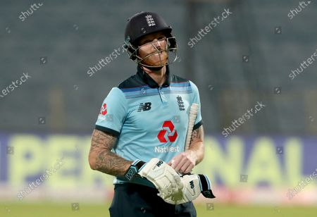 England's Ben Stokes reacts as he walks off the field after losing his wicket at 99 during the second One Day International cricket match between India and England at Maharashtra Cricket Association Stadium in Pune, India