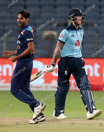 England's Ben Stokes, right, reacts after being dismissed at 99 by India's Bhuvneshwar Kumar, left, during the second One Day International cricket match between India and England at Maharashtra Cricket Association Stadium in Pune, India