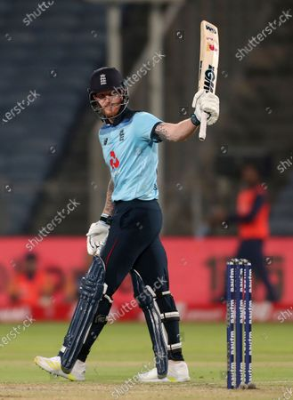 England's Ben Stokes celebrates scoring fifty runs during the second One Day International cricket match between India and England at Maharashtra Cricket Association Stadium in Pune, India