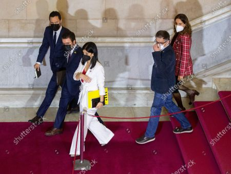 ERC's candidate for Catalonia's regional Presidency Pere Aragones (2L) arrives with his party colleagues Roger Torrent (L) and Marta Villalta (3L) at the Catalan Parliament, where he is expected to be elected as Catalonia's regional President, in Barcelona, Spain, 26 March 2021.