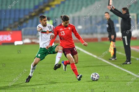 Ricardo Rodriguez of Switzerland is challenged by Ivaylo Chochev of Bulgaria  during the FIFA World Cup 2022 Qatar qualifying match between Bulgaria and Switzerland at Vasil Levski National Stadium on March 25, 2021 in Sofia, Bulgaria.