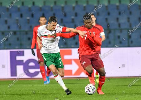 Stock Image of Georgi Kostadinov of Bulgaria is challenged by Breel Embolo of Switzerland during the FIFA World Cup 2022 Qatar qualifying match between Bulgaria and Switzerland at Vasil Levski National Stadium on March 25, 2021 in Sofia, Bulgaria.