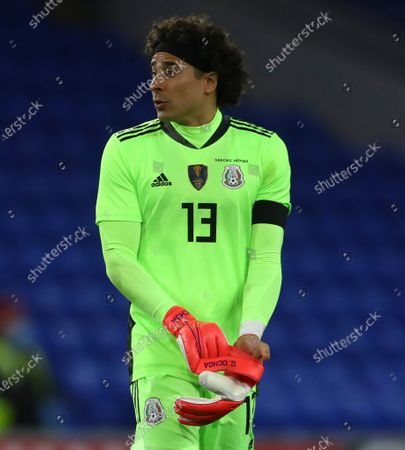Guillermo Ochoa of Mexico puts on his personalised Nike goalkeeping gloves