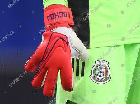 The personalised Nike goalkeeping glove of Guillermo Ochoa of Mexico