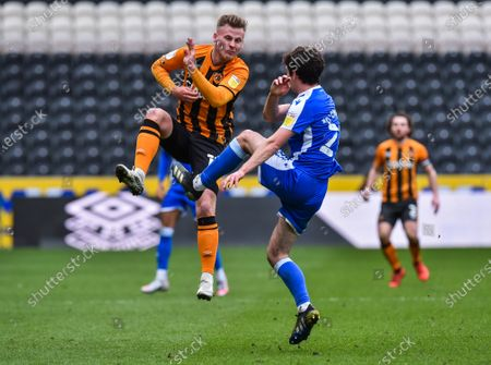 James Scott of Hull City and Thomas O'Connor of Gillingham