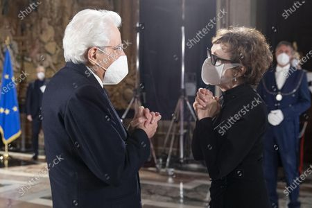 Stock Picture of Italian actress Nicoletta Braschi greets Italian Republic President Sergio Mattarella during the ceremony for the celebration of the 700th anniversary of Dante Alighieri's death at the Quirinale palace
