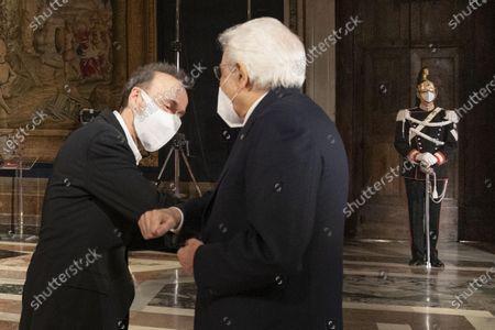 Italian actor and director Roberto Bengni greets Italian Republic President Sergio Mattarella during the ceremony for the celebration of the 700th anniversary of Dante Alighieri's death at the Quirinale palace