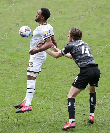 Stock Picture of Cameron Jerome of Milton Keynes Dons and Tom Anderson of Doncaster Rovers  in action