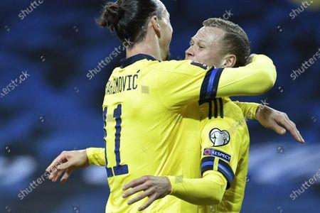 Sweden's Zlatan Ibrahimovic and Viktor Claesson celebrating