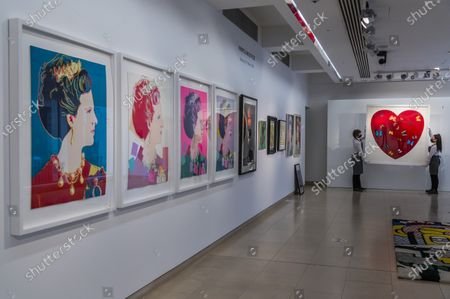 Andy Warhol, Queen Margarethe II of Denmark, from:Reigning Queens (Royal Edition)the set of four screenprints in colours with diamond dust, numbered R26/30Estimate: £60,000-80,000 with Damien Hirst, Big Love, 2010, numbered48/50, Estimate: £30,000-50,000 and other works - Behind Closed Doors: Preparations take place at Christie's ahead of the Prints & Multiples and Banksy: I Can't Believe You Morons Actually Buy This Sh*T Online Sales. The sales take place between 16-31 March and are both online.