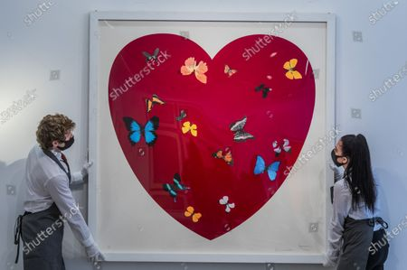Stock Image of Damien Hirst, Big Love, 2010, numbered48/50, Estimate: £30,000-50,000 - Behind Closed Doors: Preparations take place at Christie's ahead of the Prints & Multiples and Banksy: I Can't Believe You Morons Actually Buy This Sh*T Online Sales. The sales take place between 16-31 March and are both online.