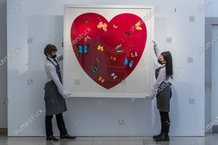 Stock Picture of Damien Hirst, Big Love, 2010, numbered48/50, Estimate: £30,000-50,000 - Behind Closed Doors: Preparations take place at Christie's ahead of the Prints & Multiples and Banksy: I Can't Believe You Morons Actually Buy This Sh*T Online Sales. The sales take place between 16-31 March and are both online.
