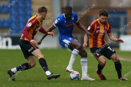 Frank Nouble of Colchester United (45) and Gareth Evans of Bradford City (17)