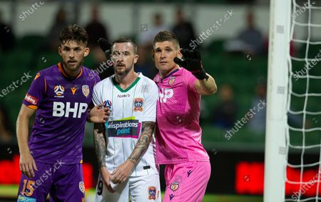 Liam Reddy and Brandon Wilson of the Perth Glory wait for the corner kick with Roy O'Donovan of the Newcastle Jets; HBF Park, Perth, Western Australia, Australia; A League Football, Perth Glory versus Newcastle Jets.