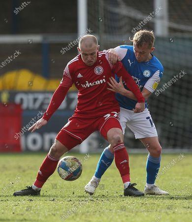 Accrington Stanley's David Morgan holds off Peterborough's Louis Reed