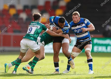 Anthony Watson of Bath is tackled by Ollie Hassell-Collins and Nick Phipps of London Irish; Brentford Community Stadium, London, England; Gallagher Premiership Rugby, London Irish versus Bath.