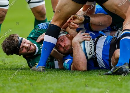Henry Thomas of Bath holding onto the ball during tackle; Brentford Community Stadium, London, England; Gallagher Premiership Rugby, London Irish versus Bath.