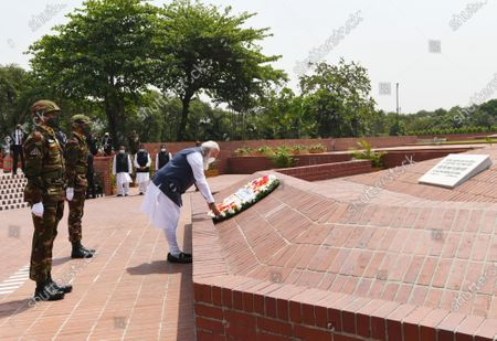 In this photo provided by Prime Minister of India Narendra Modi's twitter handle, Indian Prime Minister Narendra Modi places a floral wreath at the National Martyrs' Memorial in Dhaka, Bangladesh, . Modi arrived in Bangladesh's capital on Friday to join celebrations marking 50 years of the country's independence, but his trip was not welcomed by all. The two-day visit, his first foreign trip since the coronavirus pandemic began last year, will also include joining commemorations for 100 years since the birth of independence leader Sheikh Mujibur Rahman, the father of current Prime Minister Sheikh Hasina