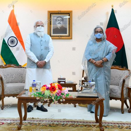 In this photo provided by Prime Minister of India Narendra Modi's twitter handle, Indian Prime Minister Narendra Modi and Bangladesh's Prime Minister Sheikh Hasina stands for a photograph in Dhaka, Bangladesh, . Modi on Saturday concluded his two-day official visit to Bangladesh amid both violent protests and enthusiasm that the bilateral relations between the two neighbors would continue to grow