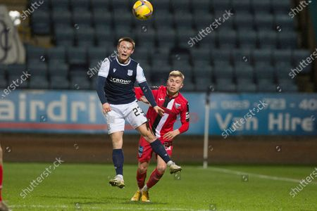 Jordan Marshall of Dundee heads clear from Fraser Murray of Dunfermline Athletic; Dens Park, Dundee, Scotland; Scottish Championship Football, Dundee FC versus Dunfermline.