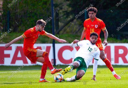 Wales vs Republic of Ireland . Wales' Joe Adams is tackled by Ireland's Andrew Omobamidele