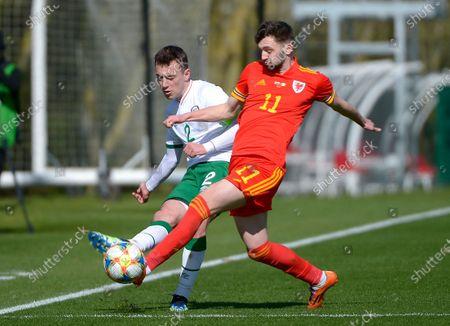 Wales vs Republic of Ireland . Wales' Joe Adams with Ireland's Lee O'Connor