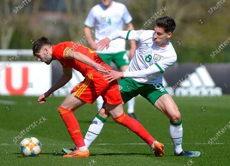 Wales vs Republic of Ireland . Wales' Joe Adams with Ireland's Conor Noss
