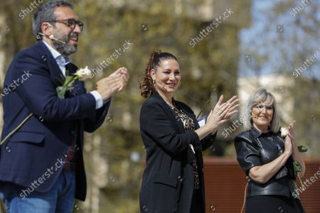 Stock Image of The singers (from left to right) Jose Manuel Zapata, Marina Heredia and Mariola Cantarero clapping during a tribute to the health workers of the Virgen de las Nieves University Hospital with a performance by the Granada City Choir.