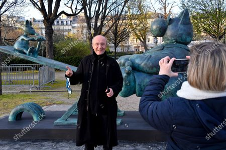 Stock Photo of Yann Arthus-Bertrand and Philippe Geluck - Paris: Philippe Geluck's Cats take over the Champs-Elysees. Twenty bronze sculptures of the Cat of Philippe Geluck are displayed on the Champs-Elysees as of this Friday.