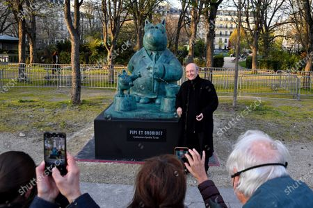 Stock Image of Yann Arthus-Bertrand and Philippe Geluck - Paris: Philippe Geluck's Cats take over the Champs-Elysees. Twenty bronze sculptures of the Cat of Philippe Geluck are displayed on the Champs-Elysees as of this Friday.