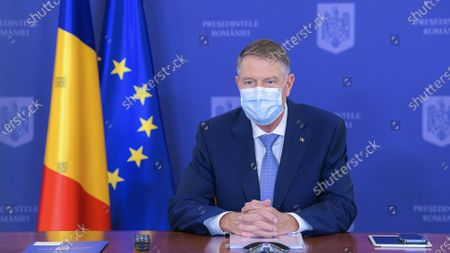 Stock Photo of (210326) - BRUSSELS, March 26, 2021 (Xinhua) - Romanian President Klaus Iohannis await the first-day meeting of the EU spring summit, March 25, 2021. EU leaders puts via video link on Thursday to start the two-day EU spring summit.